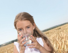 Blond girl drinking clean water