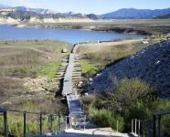 A dock at Lake Cachuma in Santa Barbara County, California, sits on dry land as the reservoir is at less than 14 percent capacity | Tara Lohan